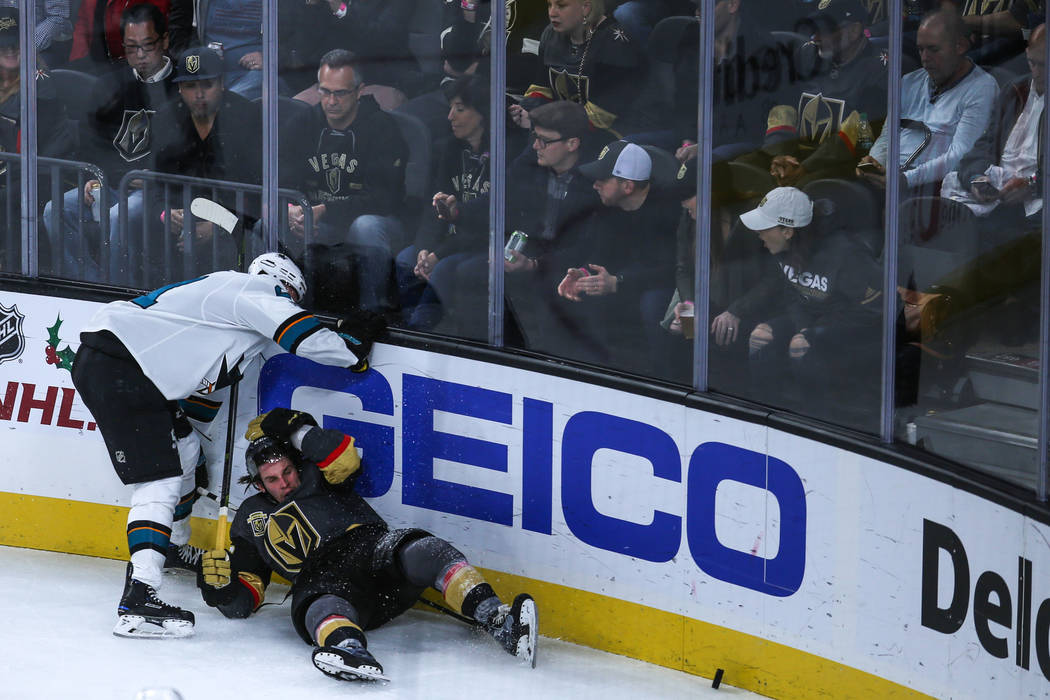 San Jose Sharks defenseman Justin Braun (61), left, knocks down Vegas Golden Knights left wing Erik Haula (56), right, during the second period of a hockey game at T-Mobile Arena in Las Vegas, Fri ...