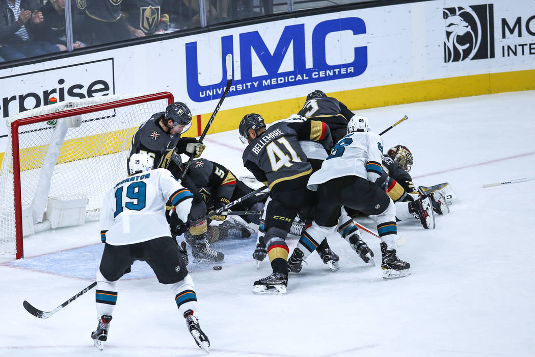 The Vegas Golden Knights scramble as they protect the goal against the San Jose Sharks during the second period of a hockey game at T-Mobile Arena in Las Vegas, Friday, Nov. 24, 2017. Joel Angel J ...