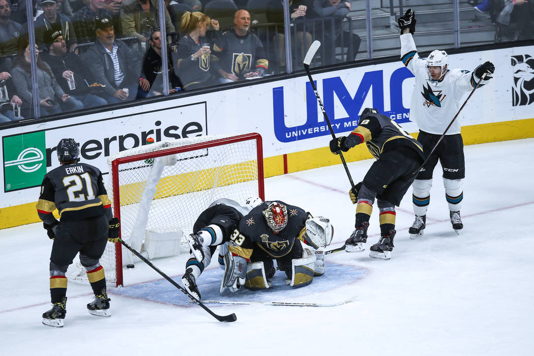 San Jose Sharks center Chris Tierney (50), second from left, scores against the Vegas Golden Knights during the second period of a hockey game at T-Mobile Arena in Las Vegas, Friday, Nov. 24, 2017 ...