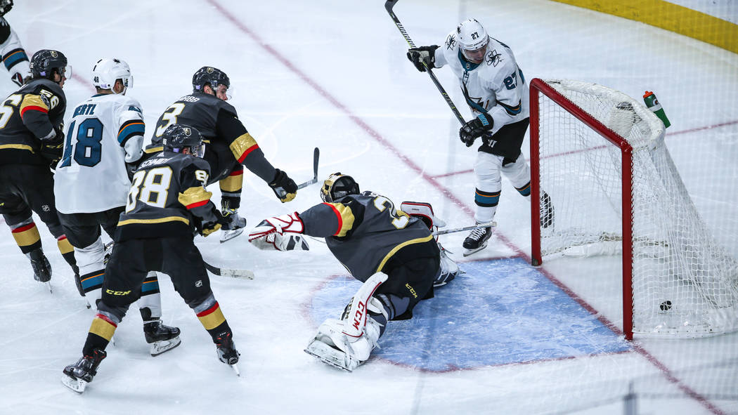 San Jose Sharks center Tomas Hertl (48), second from left, scores on Vegas Golden Knights goalie Malcolm Subban (30), second from right, during the third period of a hockey game at T-Mobile Arena  ...