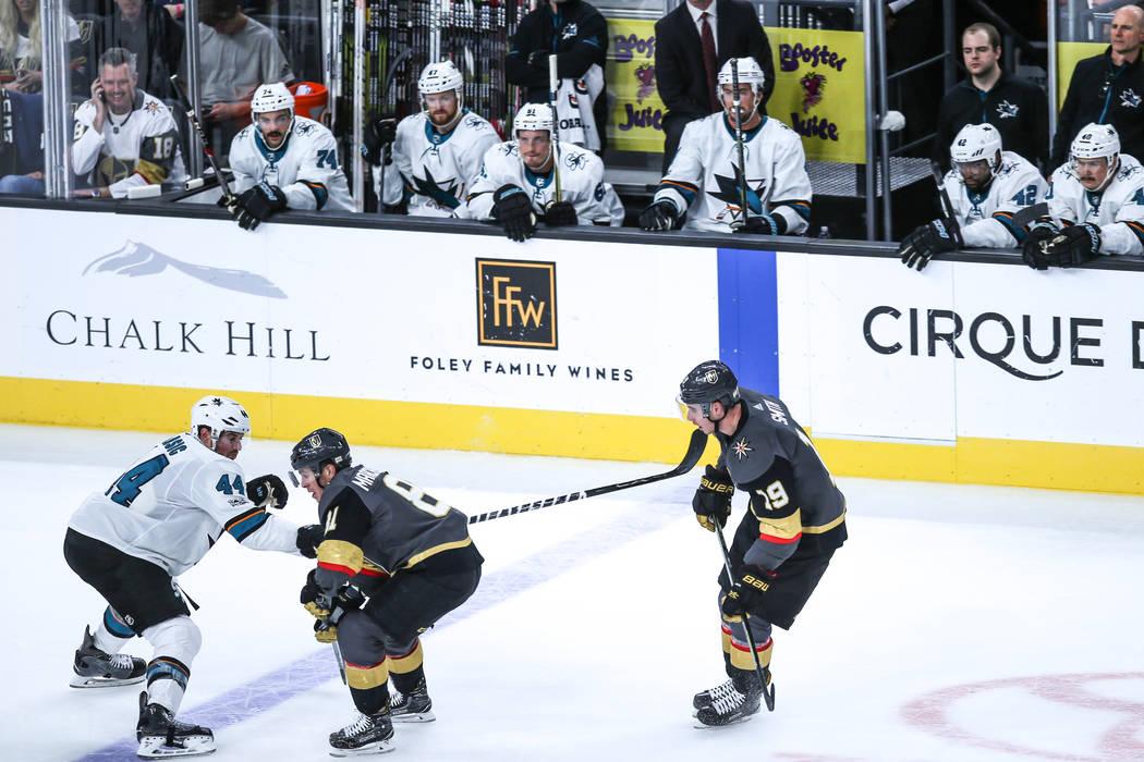 San Jose Sharks defenseman Marc-Edouard Vlasic (44), left, Vegas Golden Knights center Jonathan Marchessault (81), center, and Vegas Golden Knights right wing Reilly Smith (19), right, skate on th ...