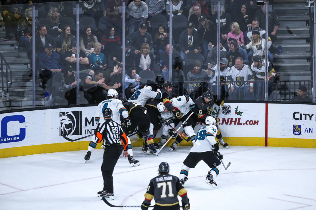 The Vegas Golden Knights and the San Jose Sharks scramble over the puck during the third period of a hockey game at T-Mobile Arena in Las Vegas, Friday, Nov. 24, 2017. Vegas Golden Knights won 5-4 ...