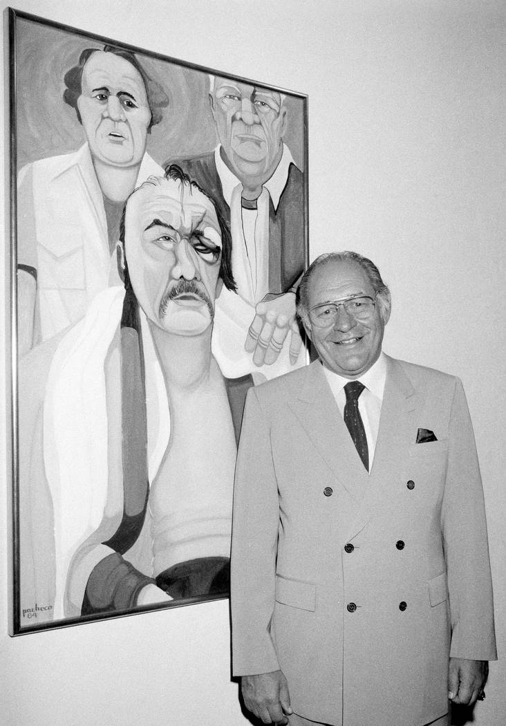 Ferdie Pacheco stands in front of his painting of boxer Chuck Wepner at Manhattan's Spectrum Fine Art Gallery in New York on May 10, 1984. Pacheco, the former ringside physician of Muhammed Ali pa ...