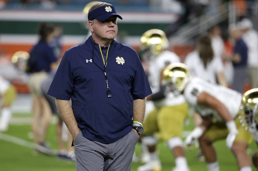 FILE - In this Nov. 11, 2017, file photo, Notre Dame head coach Brian Kelly walks on the field before an NCAA college football game against Miami in Miami Gardens, Fla. The game between No. 9 Notr ...