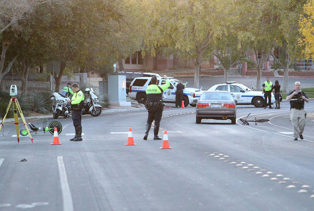 Henderson Police investigate at the scene of a crash involving a boy riding a bicycle near near the intersection of Silver Springs Parkway and Tomahawk Drive, near Valle Verde Drive Friday, Nov. 2 ...