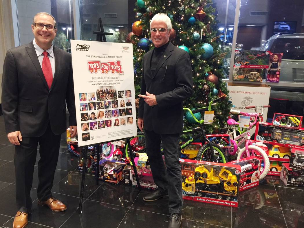 """Findlay Cadillac Findlay Cadillac General Manager John Saksa, left, and dealership marketing and promotions director Laurence """"L.J."""" Harness kick off the 2017 Toys for Tots campaign at the dea ..."""