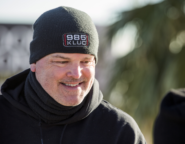 Chet Buchanan, host at 98.5 KLUC, smiles while standing on top of a 30-foot scaffolding during the 18th Annual Chet Buchanan & The Morning Zoo Toy Drive on Thursday, Dec. 08, 2016. He camps ou ...