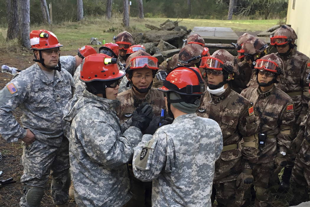 Soldiers from the U.S. Army and China's People's Liberation Army carry out a joint rescue response to a natural disaster in an exercise at Camp Rilea Armed Forces Training Center near Warrenton, O ...