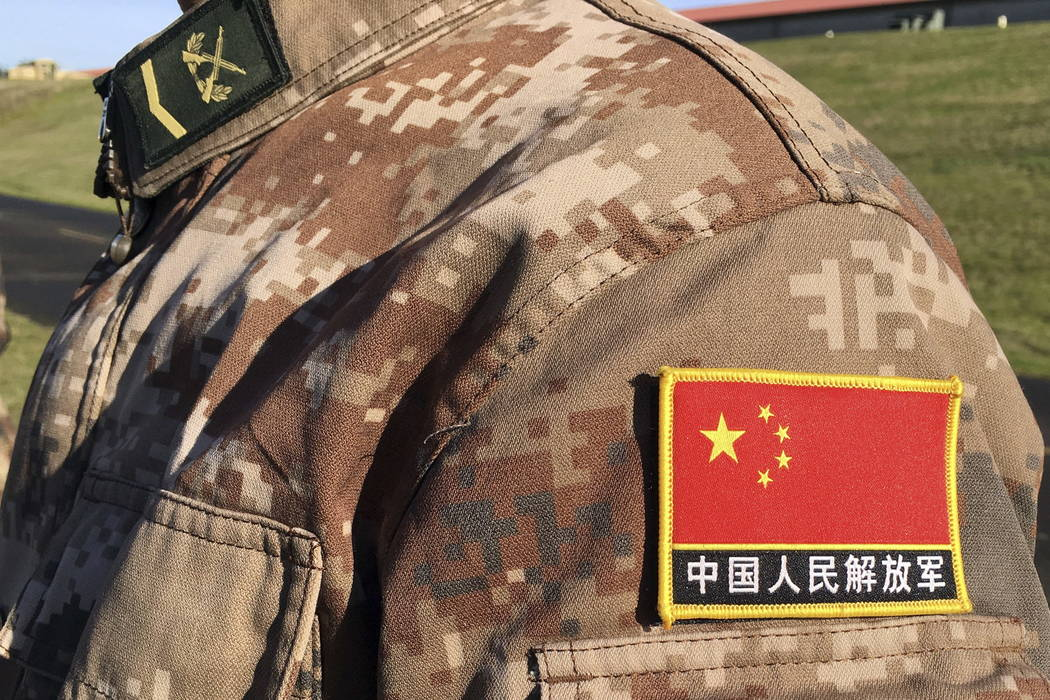 A red flag of China shoulder patch is seen on the digital camouflage uniform of a Chinese soldier participating in a joint disaster-response drill at Camp Rilea Armed Forces Training Center near W ...