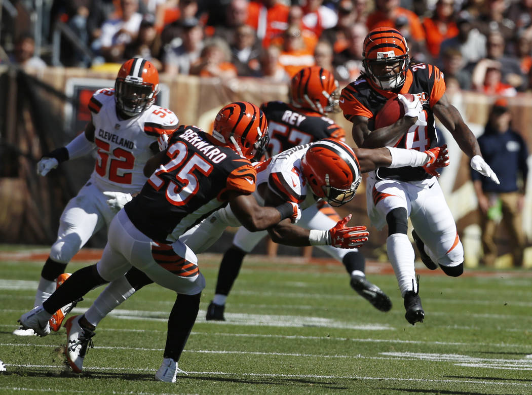 Cincinnati Bengals cornerback Adam Jones, right, returns a punt in the first half of an NFL football game against the Cleveland Browns, Sunday, Oct. 1, 2017, in Cleveland. (AP Photo/Ron Schwane)