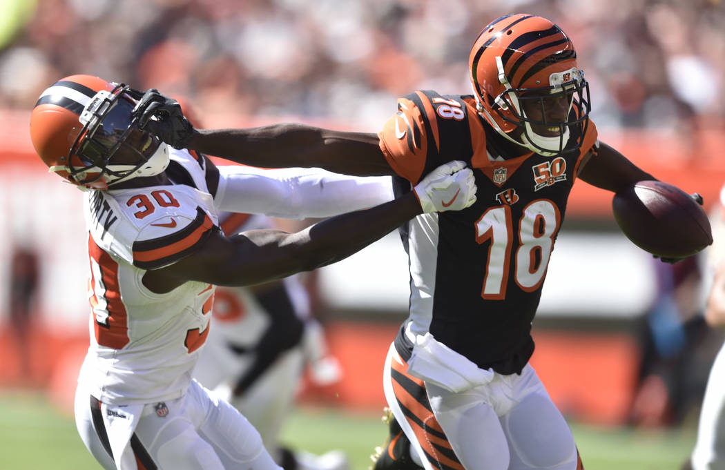 Cincinnati Bengals wide receiver A.J. Green (18) blocks Cleveland Browns defensive back Jason McCourty (30) in the first half of an NFL football game, Sunday, Oct. 1, 2017, in Cleveland. (AP Photo ...