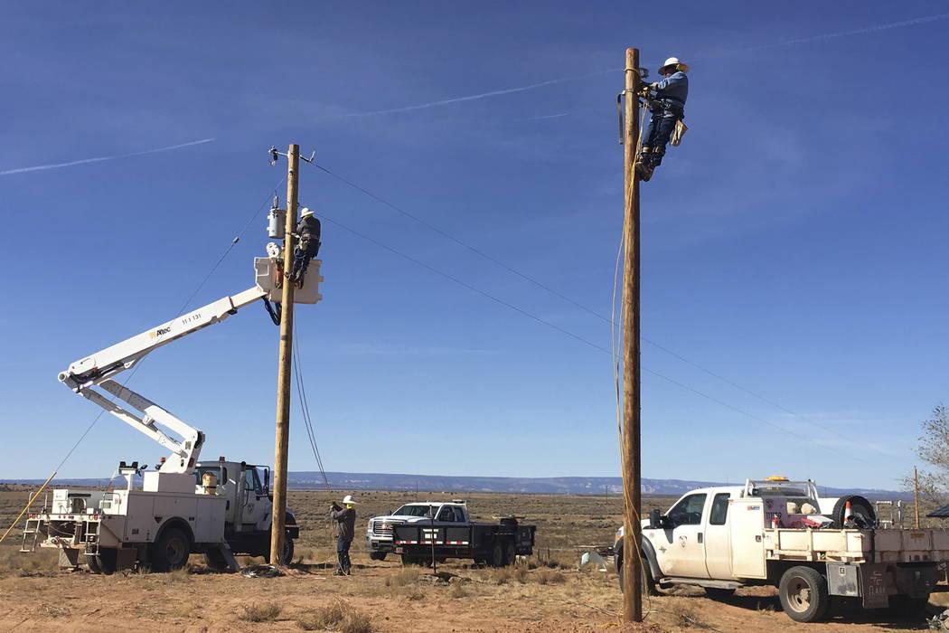 Workers run electricity to Annie Hamm's home on the Navajo Nation near Montezuma Creek, Utah. (Deenise Becenti/Navajo Tribal Utility Authority via AP)