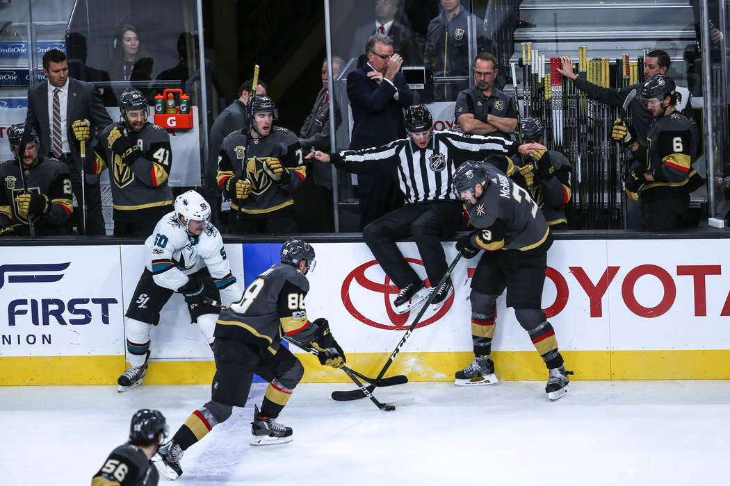 San Jose Sharks center Chris Tierney (50), left, Vegas Golden Knights defenseman Nate Schmidt (88), center, and Vegas Golden Knights defenseman Brayden McNabb (3), right, chase after the puck duri ...