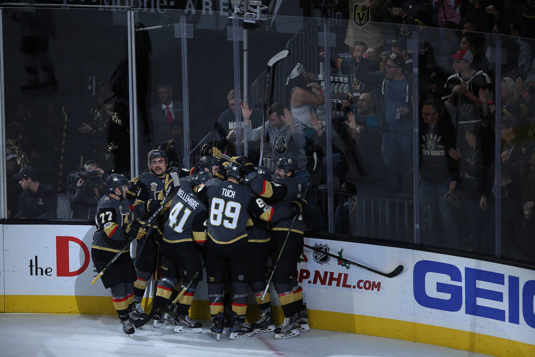 Vegas Golden Knights celebrate after winning in overtime during a hockey game against the San Jose Sharks at T-Mobile Arena in Las Vegas, Friday, Nov. 24, 2017. Vegas Golden Knights won 5-4. Joel  ...
