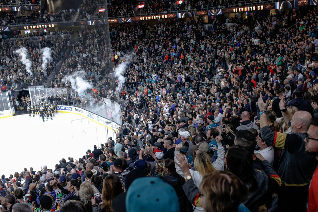 Fans celebrate after the Vegas Golden Knights defeated the San Jose Sharks in overtime during a hockey game at T-Mobile Arena in Las Vegas, Friday, Nov. 24, 2017. Vegas Golden Knights won 5-4. Joe ...