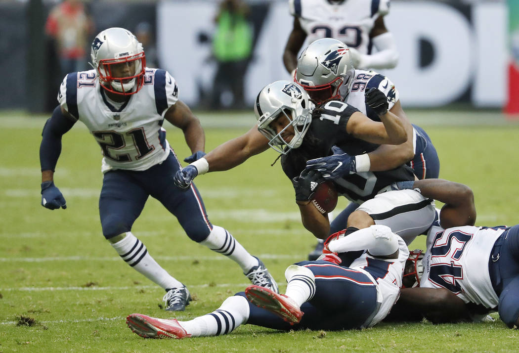 Oakland Raiders wide receiver Seth Roberts (10) is tackled by New England Patriots defensive end Trey Flowers (98) during the second half of an NFL football game, Sunday, Nov. 19, 2017, in Mexico  ...