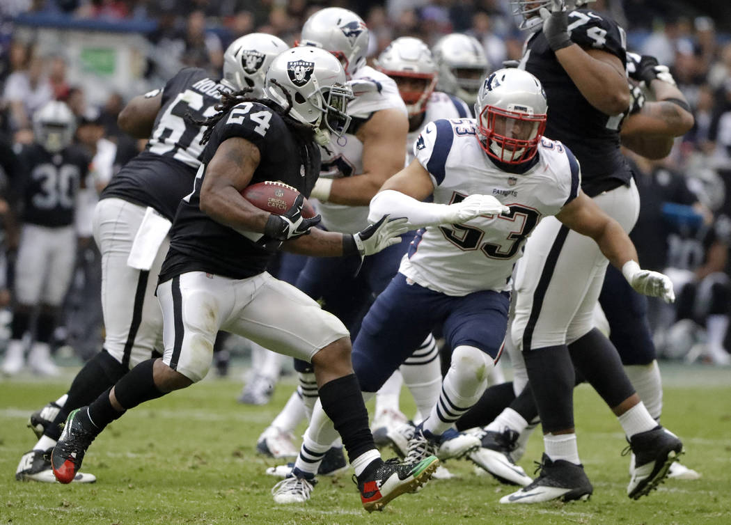 Oakland Raiders running back Marshawn Lynch (24) rushes against New England Patriots middle linebacker Dont'a Hightower (53) during the second half of an NFL football game Sunday, Nov. 19, 2017, i ...