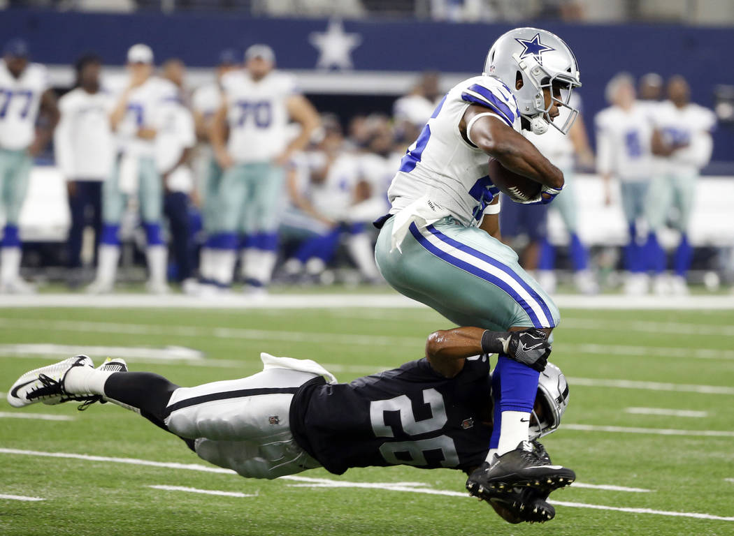 Oakland Raiders safety Shalom Luani (26) dives to make the stop against Dallas Cowboys running back Alfred Morris in the second half of a preseason NFL football game, Saturday, Aug. 26, 2017, in A ...