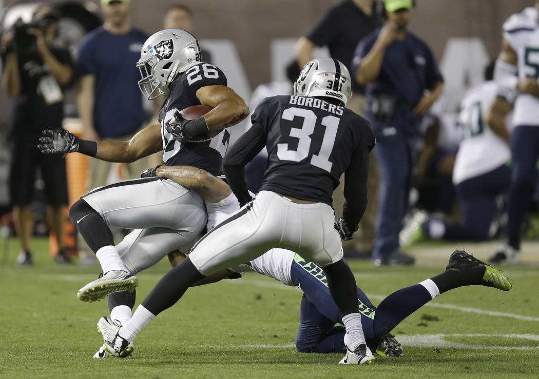 Oakland Raiders safety Shalom Luani (26) intercepts a pass against the Seattle Seahawks during the first half of an NFL preseason football game in Oakland, Calif., Thursday, Aug. 31, 2017. (AP Pho ...