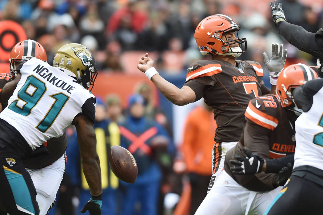 Nov 19, 2017; Cleveland, OH, USA; Jacksonville Jaguars defensive end Yannick Ngakoue (91) strips the ball from Cleveland Browns quarterback DeShone Kizer (7) during the first quarter at FirstEnerg ...
