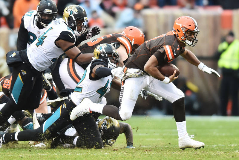 Nov 19, 2017; Cleveland, OH, USA; Cleveland Browns quarterback DeShone Kizer (7) is chased down by Jacksonville Jaguars strong safety Barry Church (42) during the second half at FirstEnergy Stadiu ...