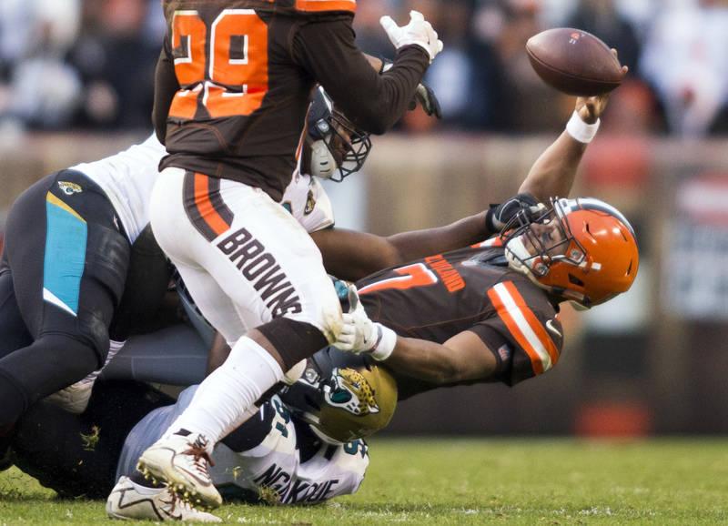 Nov 19, 2017; Cleveland, OH, USA; Cleveland Browns quarterback DeShone Kizer (7) fumbles the ball as Jacksonville Jaguars defensive end Yannick Ngakoue (91) tackles him during the fourth quarter a ...