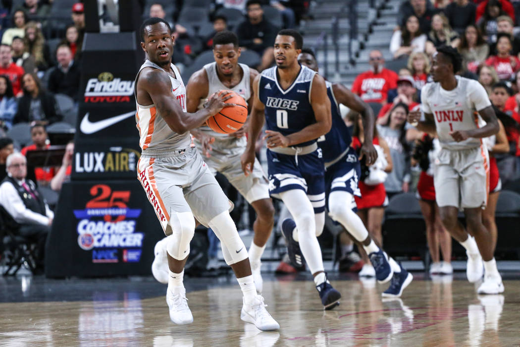 UNLV Rebels guard Jordan Johnson (24) dribbles the ball during the first half of basketball game against the Rice Owls during day one of the MGM Grand Main Event tournament at T-Mobile Arena in La ...