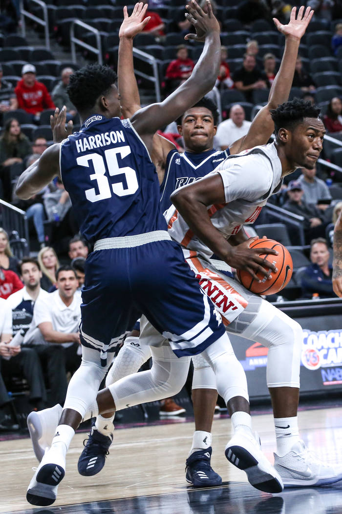 UNLV Rebels forward Brandon McCoy (44), right, is guarded by Rice Owls forward Tim Harrison (35), left, during the first half of basketball game during day one of the MGM Grand Main Event tourname ...