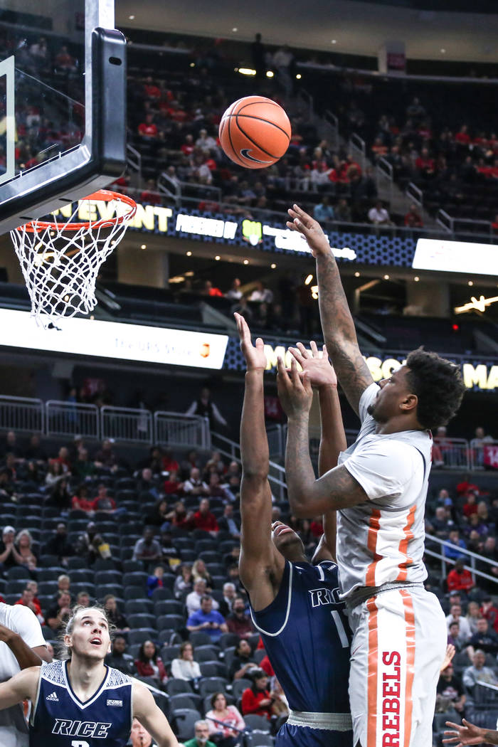 UNLV Rebels forward Tervell Beck (14), right, shoots a rebound during the first half of basketball game against the Rice Owls during day one of the MGM Grand Main Event tournament at T-Mobile Aren ...