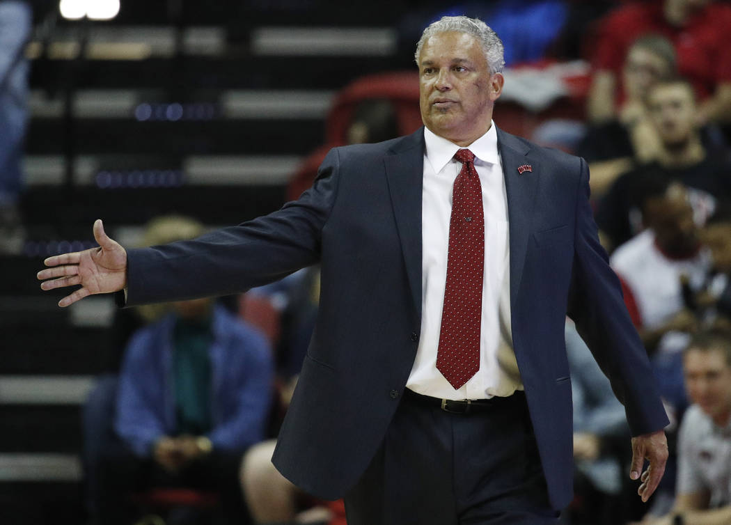 UNLV coach Marvin Menzies gestures during the first half of the team's NCAA college basketball game against Southern Utah, Saturday, Nov. 25, 2017, in Las Vegas. (AP Photo/John Locher)