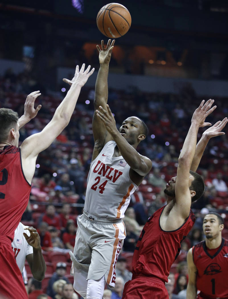 UNLV's Jordan Johnson (24) shoots over Southern Utah's Ivan Madunic, left, during the first half of an NCAA college basketball game Saturday, Nov. 25, 2017, in Las Vegas. (AP Photo/John Locher)