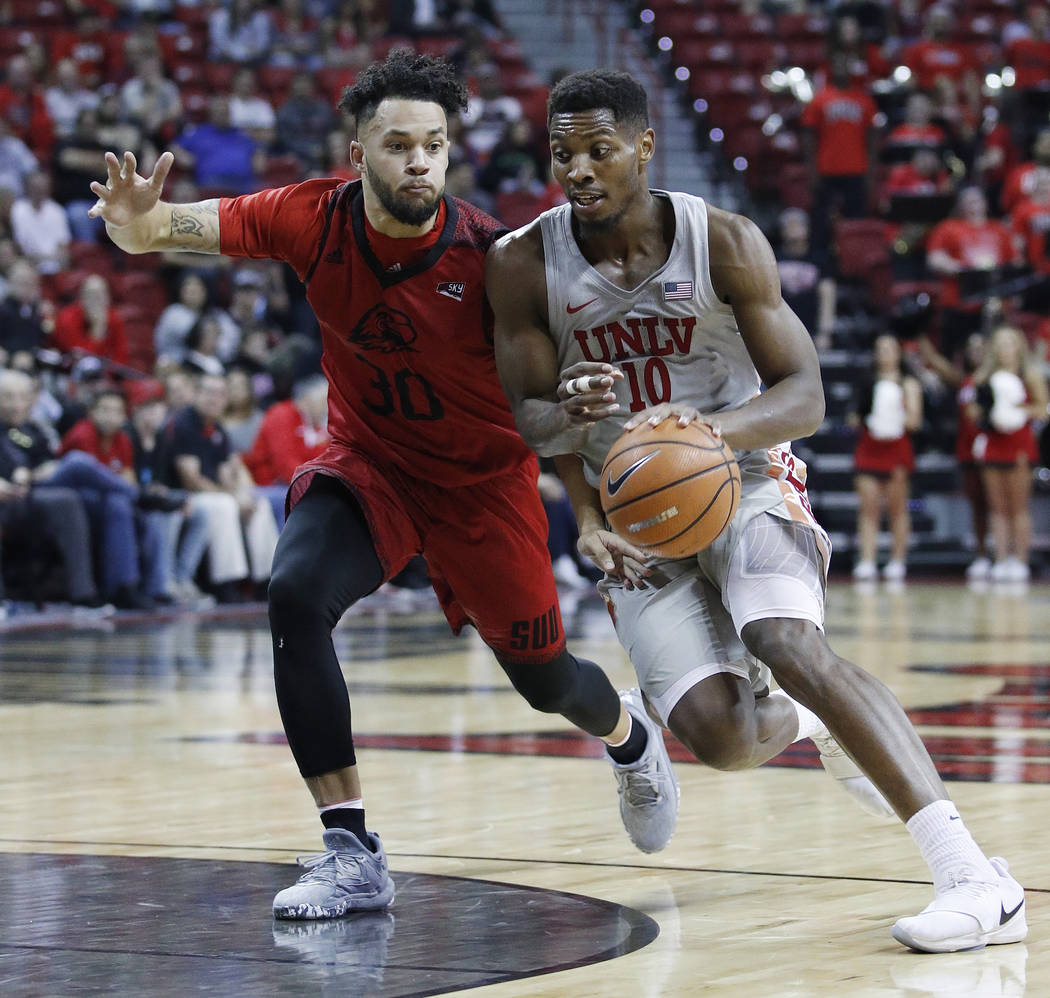 UNLV's Shakur Juiston drives around Southern Utah's Elijah Graves during the first half of an NCAA college basketball game Saturday, Nov. 25, 2017, in Las Vegas. (AP Photo/John Locher)