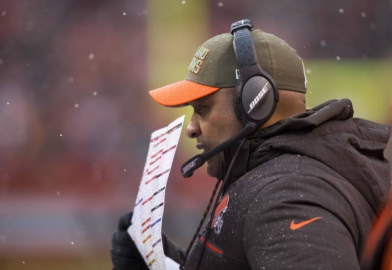 Nov 19, 2017; Cleveland, OH, USA; Cleveland Browns head coach Hue Jackson talks into his headset during the second quarter against the Jacksonville Jaguars at FirstEnergy Stadium. Mandatory Credit ...