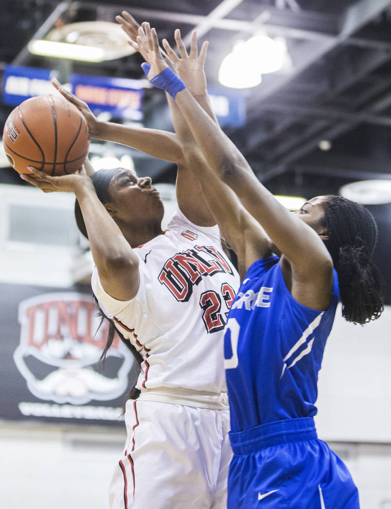UNLV's Jordyn Bell (23) shoots a contested jump shot over Air Force's Venessannah Itugbu (10) during the Rebels home matchup with the Falcons on Wednesday, Feb. 22, 2017, at Cox Pavilion, in Las V ...