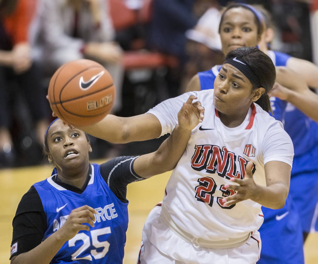 UNLV's Jordyn Bell (23) grabs a rebound over Air Force's Erika Chapman (25) during the Rebels home matchup with the Falcons on Wednesday, Feb. 22, 2017, at Cox Pavilion, in Las Vegas.  (Benjamin H ...