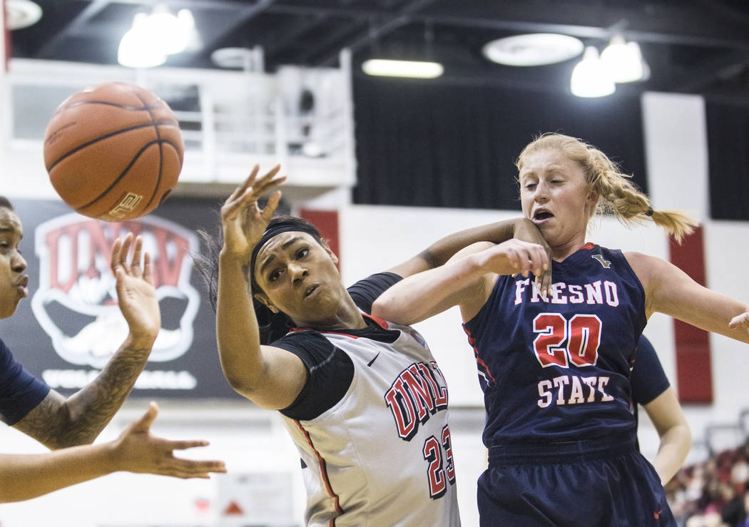 UNLV's  Jordyn Bell (23) fights for a rebound with Fresno State's Emilie Volk (20) during the Rebels home matchup with the Bulldogs on Friday, March 3, 2017, at Cox Pavilion, in Las Vegas. (Benjam ...