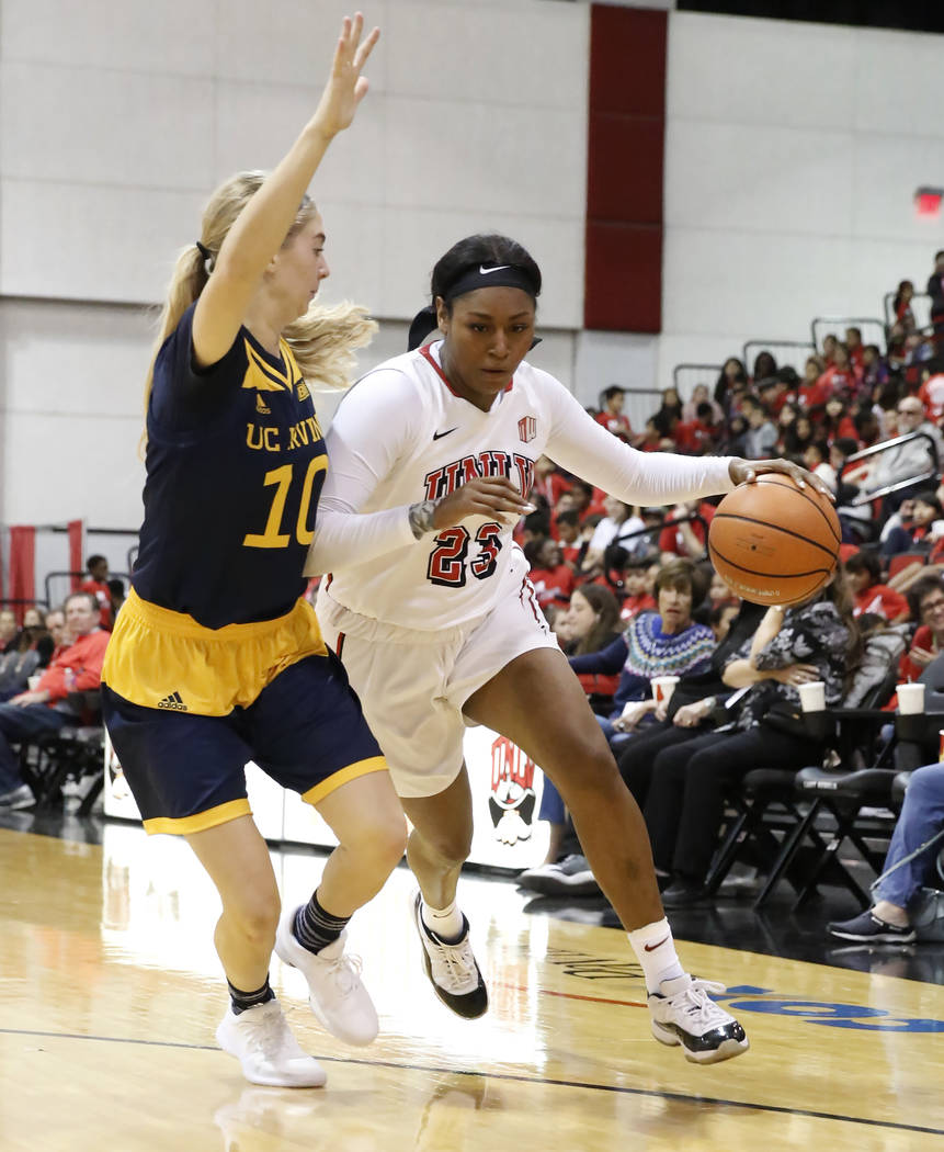 UNLV women's basketball forward Jordyn Bell (23) drives past UC Irvine's guard Andee Ritter (10) in their game at Cox Pavilion, Tuesday, Nov. 14, 2017, in Las Vegas. UNLV won 73-54. Bizuayehu Tesf ...