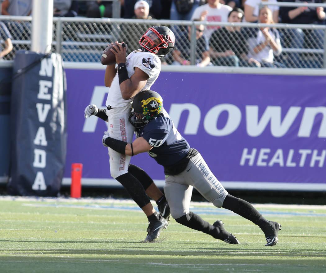 Nevada Wolf Pack linebacker Austin Paulhus (50) sacks UNLV Rebels quarterback Armani Rogers (1) during the second half of their game in Reno, Saturday, Nov. 25, 2017. Heidi Fang Las Vegas Review-J ...