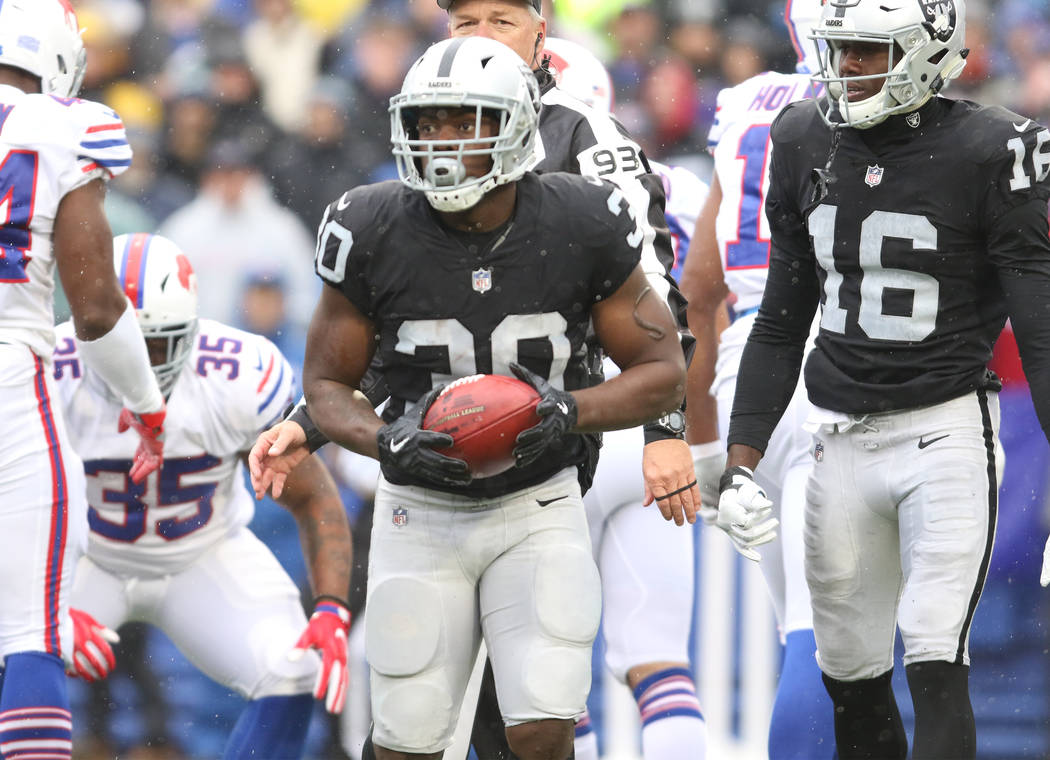 Oakland Raiders running back Jalen Richard (30) holds onto the football after a run during the first half of the NFL game against the Buffalo Bills in Orchard Park, New York, Sunday, Oct. 29, 2017 ...