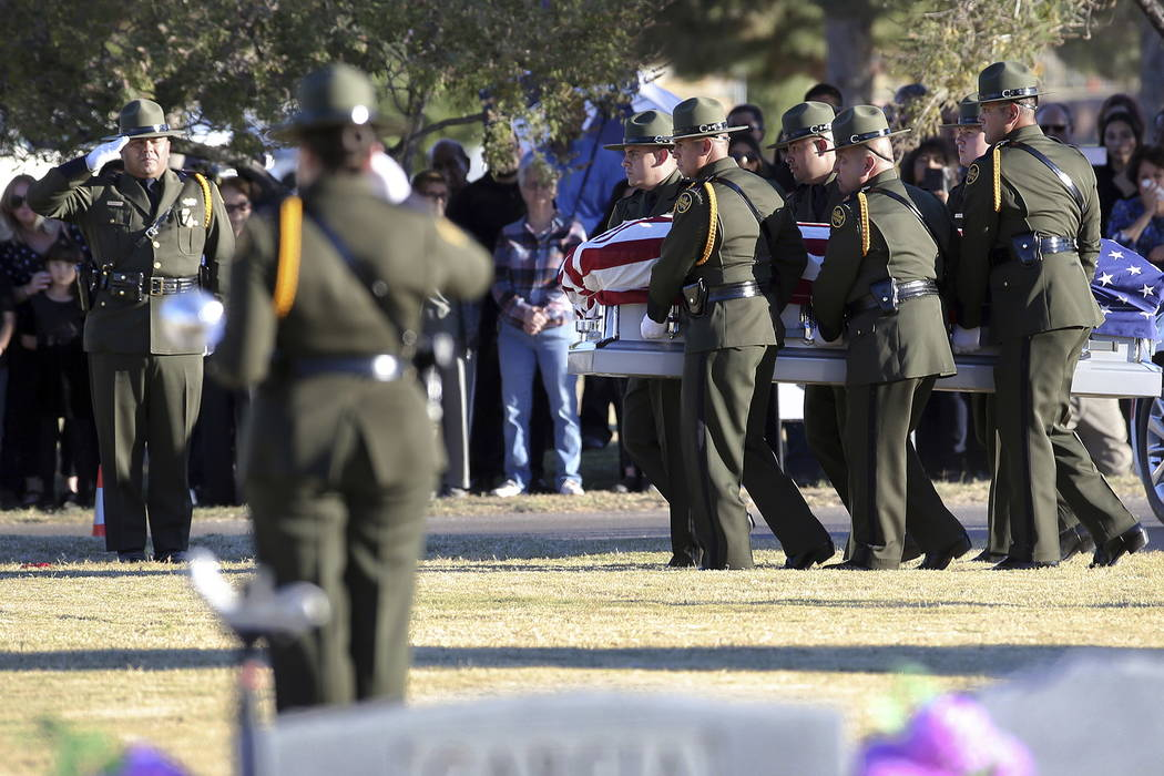 Border Patrol pallbearers carry Border Patrol agent Rogelio Martinez to a graveside service at Restlawn Cemetery, Saturday, Nov. 25, 2017 in El Paso, Texas. Martinez was on patrol in the Big Bend  ...