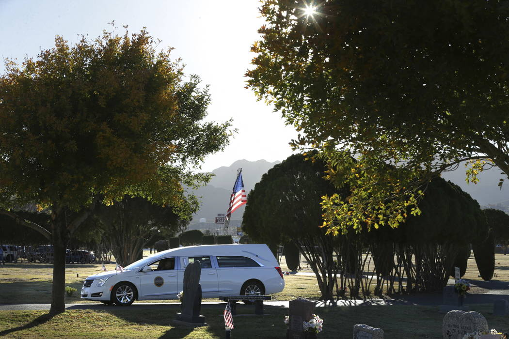 The hearse carrying Border Patrol agent Rogelio Martinez arrives at Restlawn Cemetery, Saturday, Nov. 25, 2017 in El Paso, Texas. Martinez was on patrol in the Big Bend Sector when he died in the  ...