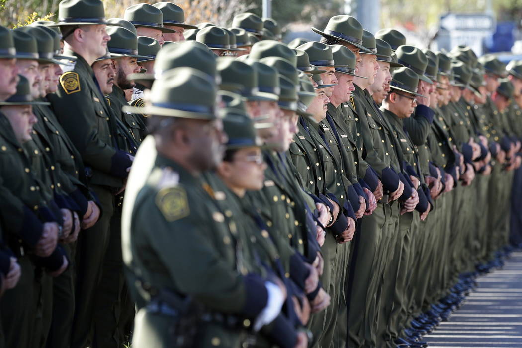 U.S. Border Patrol agents line Nashville Street outside Our Lady of Guadalupe Church for the funeral Mass of fellow Agent Rogelio Martinez, Saturday, Nov. 25, 2017 in El Paso, Texas. Martinez was  ...