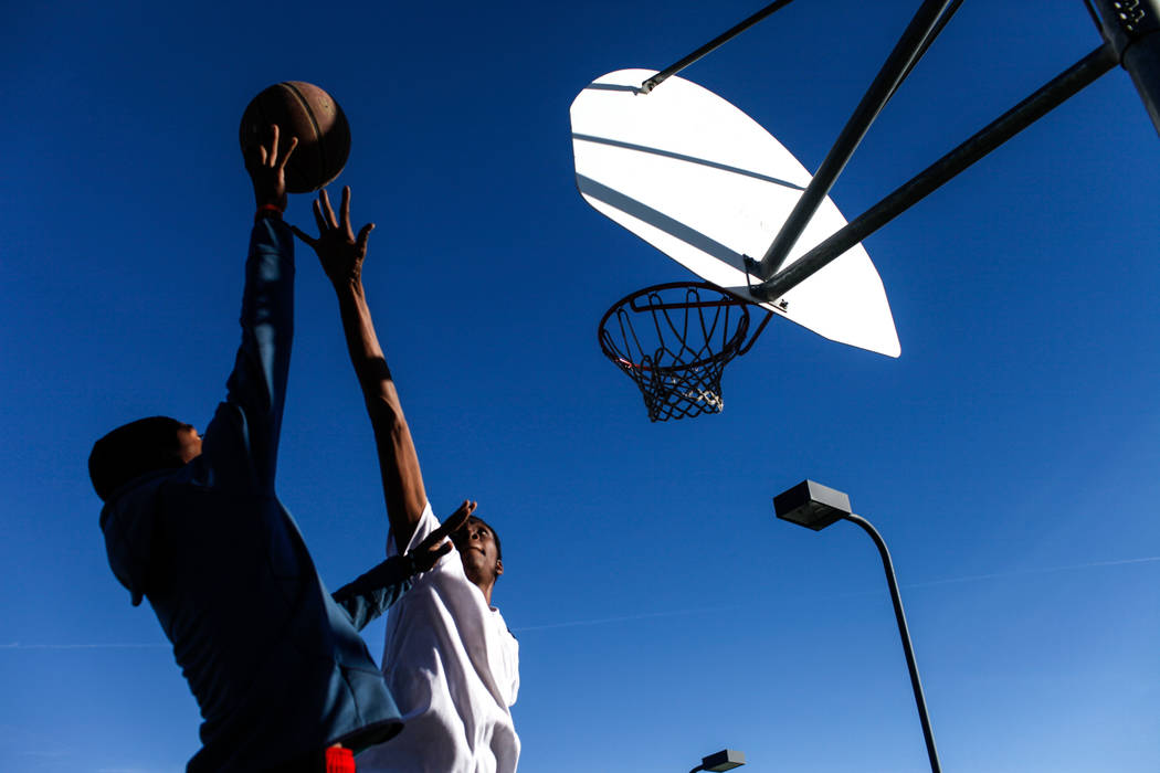 Ezekyal Anderson of Bastorp, La., and now living in Las Vegas, 18, left, and Keton Jones, of Chicago, Ill., and now living in Las Vegas, 25, right, play a pick-up basketball game at the Andre Agas ...