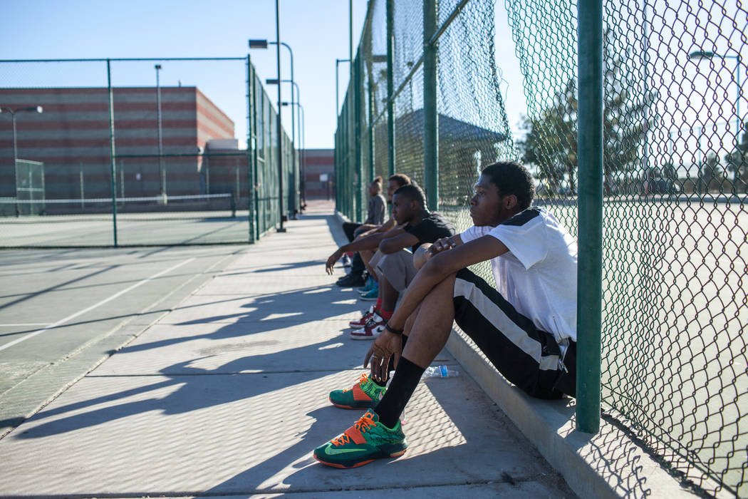 Keton Jones, of Chicago, Ill., 25, sits as he takes a break after playing a pick-up basketball game at the Andre Agassi Boys and Girls Club in Las Vegas, Sunday, Nov. 26, 2017. Joel Angel Juarez L ...