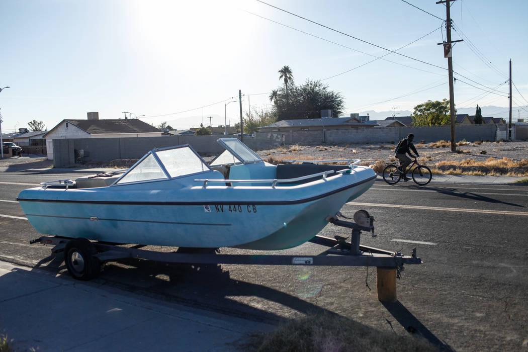 A man rides his bike past a boat parked along a residential street in Las Vegas, Sunday, Nov. 26, 2017. Joel Angel Juarez Las Vegas Review-Journal @jajuarezphoto