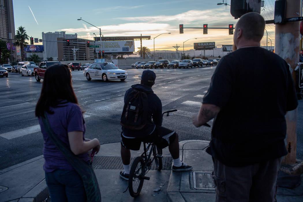 People wait to cross Las Vegas Boulevard at Sahara Avenue in Las Vegas, Sunday, Nov. 26, 2017. Joel Angel Juarez Las Vegas Review-Journal @jajuarezphoto