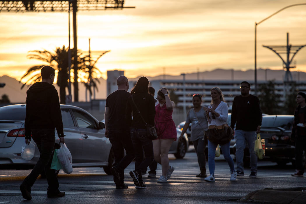 People cross Las Vegas Boulevard at Sahara Avenue in Las Vegas, Sunday, Nov. 26, 2017. Joel Angel Juarez Las Vegas Review-Journal @jajuarezphoto
