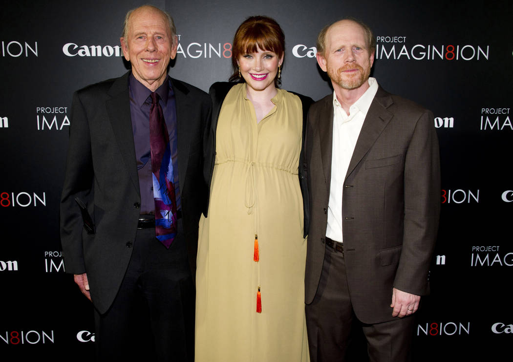 "Ron Howard, right, his daughter Bryce Dallas Howard and his father, Rance Howard, attend the premiere of ""When You Find Me,"" inspired by Canon's ""Project Imagin8ion"" contest, in New York, Nov. 15, ..."