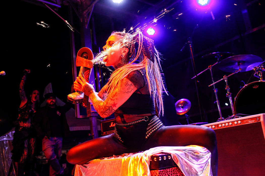 Jesabella Marie of Mich. and now living in Las Vegas, 30, takes in sparks from grinding metal as she sits on broken glass during the 25th anniversary show at the Double Down Saloon in Las Vegas, S ...