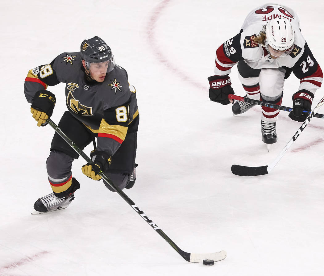 Vegas Golden Knights defenseman Nate Schmidt (88) controls the puck against Arizona Coyotes right wing Mario Kempe (29) during the third period of an NHL hockey game, Tuesday, Oct. 10, 2017, at th ...